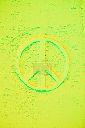 top view of peace sign in light green powder