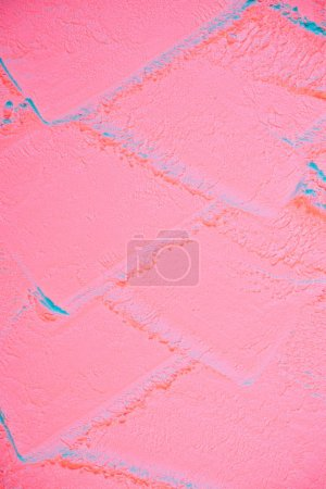 top view of tire print on pink colored flour