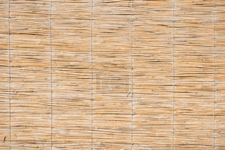 close-up view of light brown wicker background, full frame view