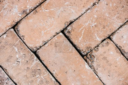 top view of old weathered brown bricks background
