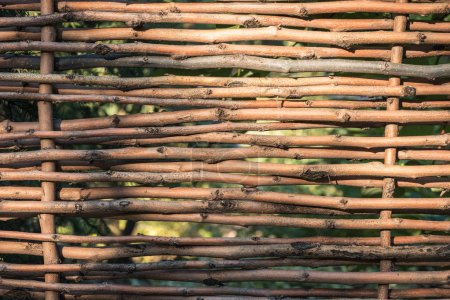 close-up view of beautiful decorative brown wicker fence background