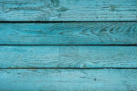 Photo pour Vue de dessus du fond en bois turquoise vif avec planches horizontales - image libre de droit