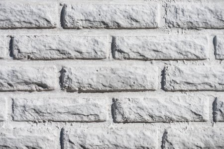close-up view of white aged brick wall background