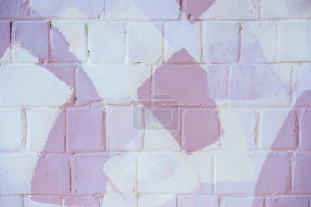light brick wall with white and pink paint, abstract background
