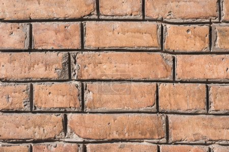 close-up view of brown aged brick wall background