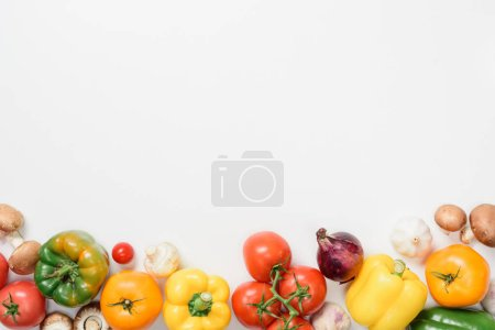 top view of ripe appetizing vegetables isolated on white