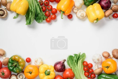 Photo for Top view of ripe bell peppers, cherry tomatoes and mushrooms isolated on white - Royalty Free Image