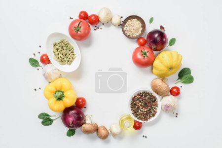 top view of circle of vegetables and spices isolated on white