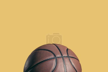 one rubber brown basketball ball isolated on yellow