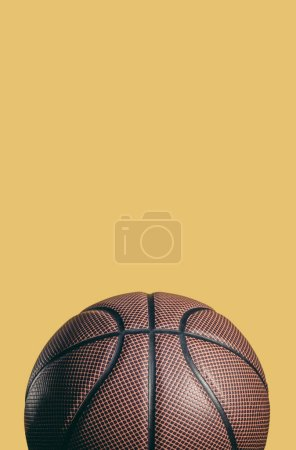 one brown basketball ball isolated on yellow