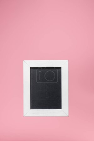 one blackboard in white frame isolated on pink
