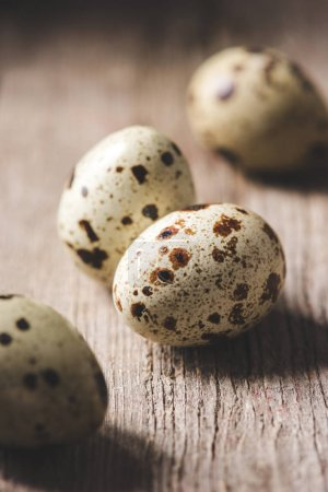 close-up view of healthy organic quail eggs on wooden table