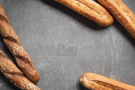 flat lay with arranged baguettes on grey surface