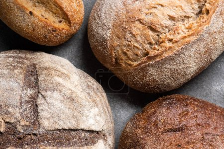 Photo for Full frame of homemade bread on grey tabletop - Royalty Free Image
