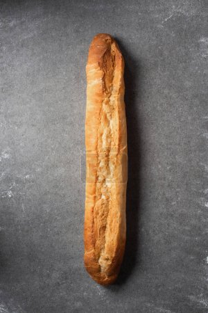 top view of baguette on grey surface