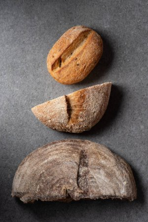 Photo for Flat lay with halves of bread on grey surface - Royalty Free Image