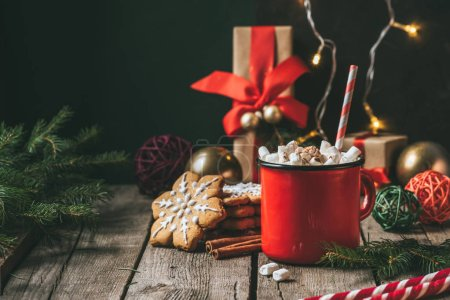 Photo for Cup of hot cocoa with marshmallows on wooden table with christmas gingerbread - Royalty Free Image