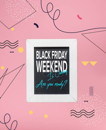 blackboard in white frame with black friday weekend is coming, are you ready?