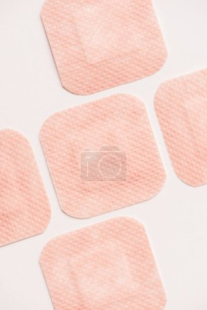 top view of adhesive bandages on white surface