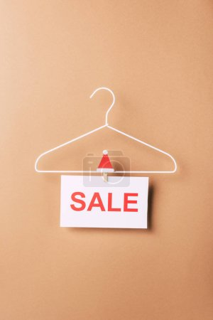 hanger with sale sign for christmas shopping on beige
