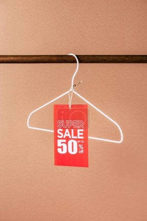 Photo for One hanger with red super sale tag - 50 percents on beige - Royalty Free Image
