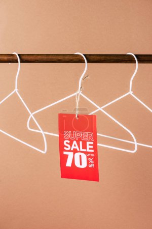 hangers with red super sale tag - 70 percents discount on beige