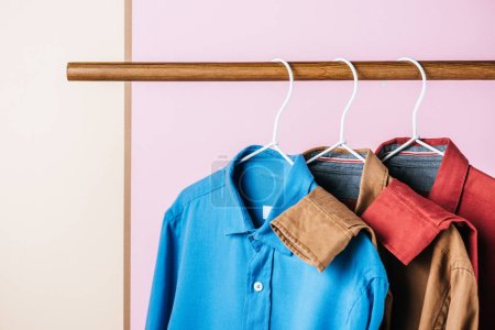 casual trendy shirts on hangers, fashion industry