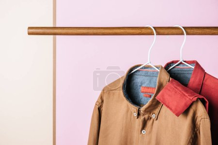 closeup of trendy shirts on hangers, fashion industry