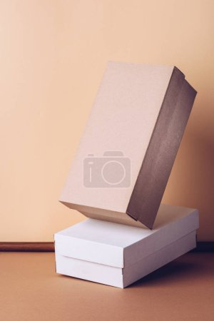 two shopping shoes boxes on beige