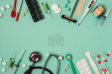 Photo for Flat lay of various medical pills and instruments on green background - Royalty Free Image
