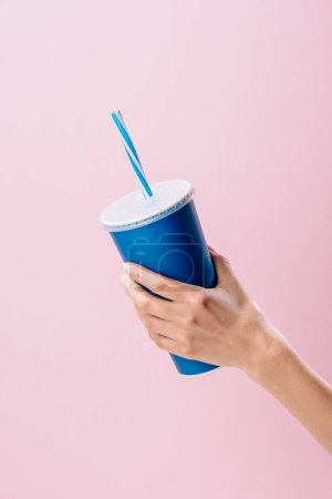 Photo for Cropped shot of woman holding paper cup with drink isolated on pink - Royalty Free Image