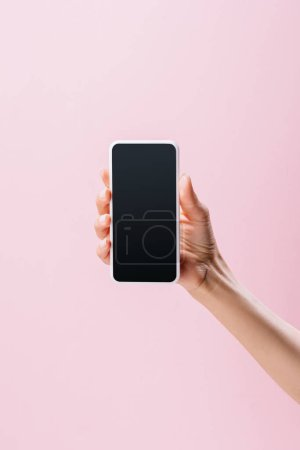 Photo for Cropped shot of woman holding smartphone with blank screen isolated on pink - Royalty Free Image