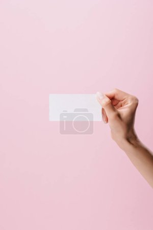 Photo for Cropped shot of woman holding blank business card isolated on pink - Royalty Free Image