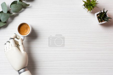 Photo for Partial view of cyborg hand sitting at table with coffee cup and plants in office - Royalty Free Image
