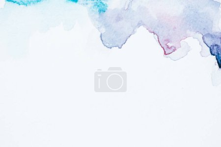 abstract blue and purple watercolor blots on white paper background with copy space