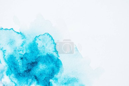 abstract bright turquoise paint blots