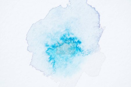 abstract bright turquoise watercolor spot on white paper