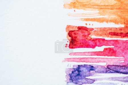 abstract background with colorful watercolor strokes on white paper