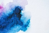 abstract bright blue watercolor painting on white paper