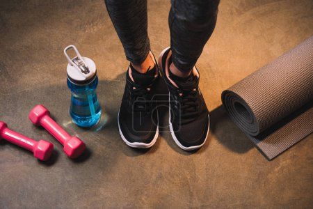 Photo for Cropped view of female legs with sports equipment - Royalty Free Image