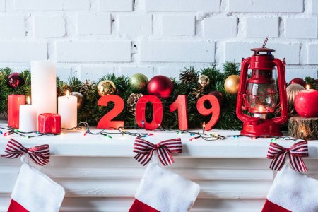 Photo for 2019 year sign with Christmas wreath, candles and socks - Royalty Free Image