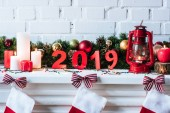 2019 year sign with Christmas wreath, candles and socks