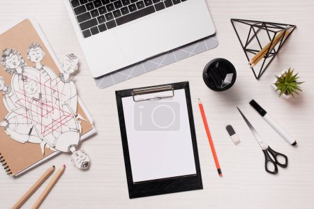 office desk with laptop, stationery and blank sheet, flat lay