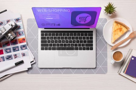 Photo for Office desk with laptop with shopping website on screen, flat lay - Royalty Free Image
