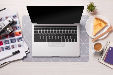 Photo for Office desk with laptop with blank screen, flat lay - Royalty Free Image