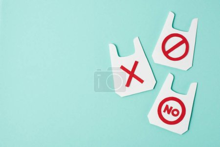 Three paper models of packets with no and prohibition signs on blue background