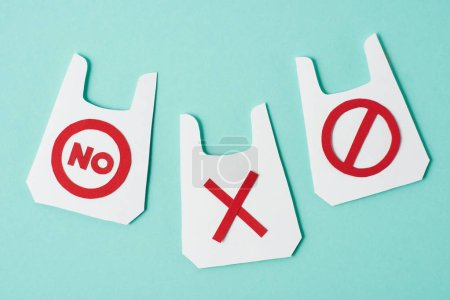 Paper models of packets with no and prohibition signs on blue background