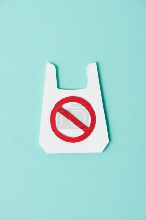 Model of white packet with prohibition sign on blue background