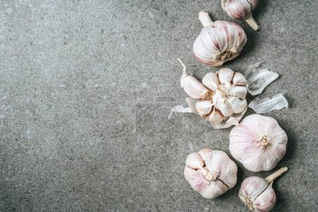 Photo for Top view of garlic bulbs and husk on grey background with copy space - Royalty Free Image