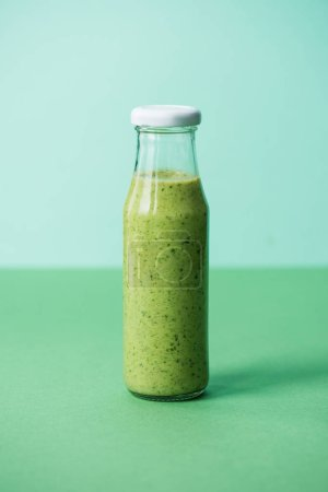 Photo for Green and fresh organic smoothie in glass bottle - Royalty Free Image